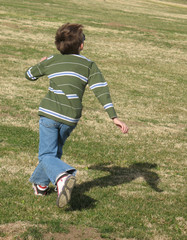 running boy focused on sky