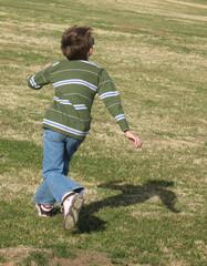 running boy focused on sky