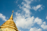 golden stupa over blue sky background with copyspace poster