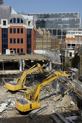 excavators on demolition site, london uk