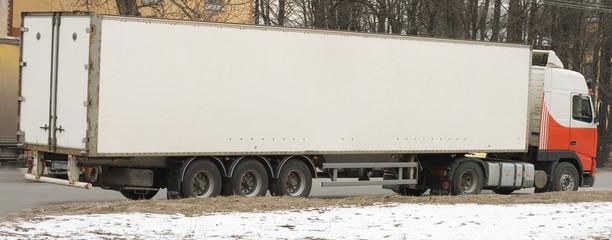 white semi tractor trailer truck