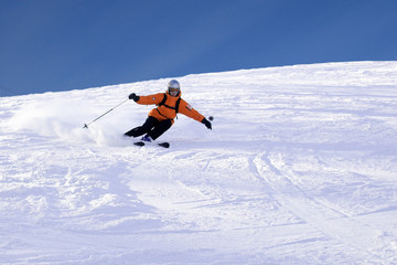 ski rider in orange sharp turn