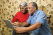 mature couple looking at laptop.
