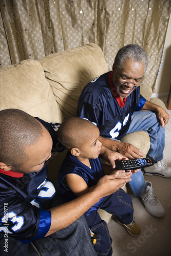 african-american family watching tv.