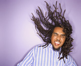 african-american man with his dreadlocks in motion.