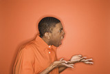 african-american man expressing anger. poster