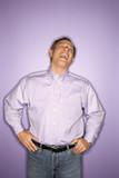 laughing caucasian man wearing purple clothing. poster