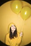 caucasian woman with balloons poster