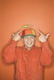 caucasian man wearing propeller cap. poster