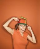 caucasian woman wearing propeller cap. poster