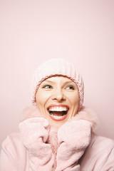 caucasian woman wearing winter coat and hat.