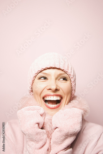 caucasian woman wearing winter coat and hat.