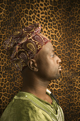 profile of man wearing traditional african clothing.