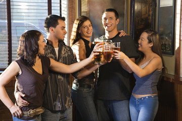 group of young adults at a bar.