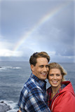 couple by ocean and rainbow in maui, hawaii. poster