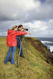 couple photographing scenery in maui, hawaii. poster
