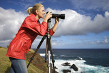 woman photographing scenery in maui, hawaii. poster