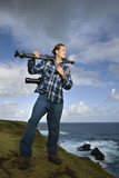 man holding photography equipment in maui, hawaii. poster