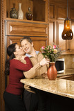man arranging flowers while being kissed. poster