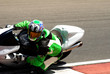 Постер, плакат: close up of a biker on a superbike on track