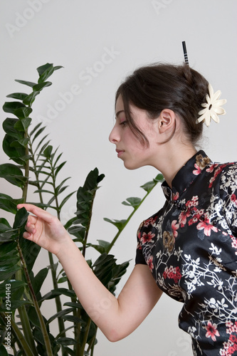 easten girl with plant