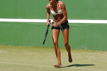 energetic woman playing tennis.