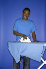 african-american teen boy ironing.