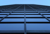 glass-windowed skyscraper reaching the sky poster
