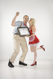 man receiving certificate from young lady. poster