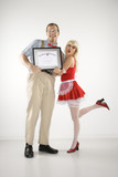 young man holding certificate with  young  woman. poster