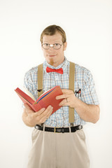 young man with book open.