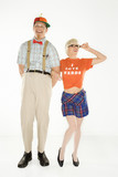 young man dressed like nerd  with young woman in nerdy outfit.