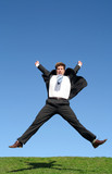 businessman leaping for joy outdoors poster