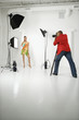 young female model being photographed  by male photographer.