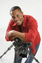 young male adult photographer posing in studio.