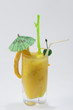 yellow drink with green umbrella on white backgrou