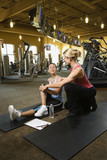adult female with personal trainer. poster