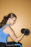 adult female lifting hand weights. poster