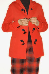 woman buttoning coat.