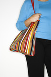 Woman holding big purse. poster