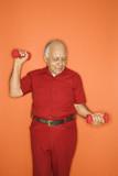 Man lifting hand weights. poster