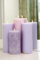 Group of purple candles burning.
