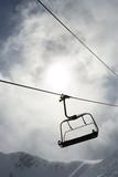 Empty chair lift at ski resort. poster