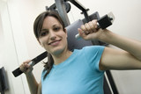 young woman goes in for sport in the gym