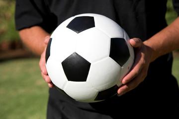 man holding soccer ball