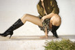 Woman crouching in boots.