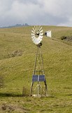 wind powered pump with solar backup poster