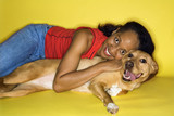 Adult female hugging dog. poster