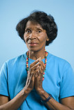 Prime adult female  with hands in prayer position. poster