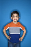 Male boy standing with hands on hips. poster